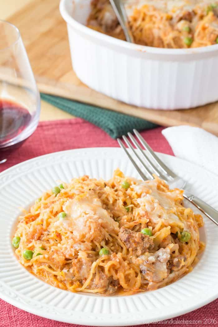 Spaghetti Squash Casserole with Spicy Sausage Tomato Cream Sauce - an easy dinner recipe that's creamy, comforting, and healthy!