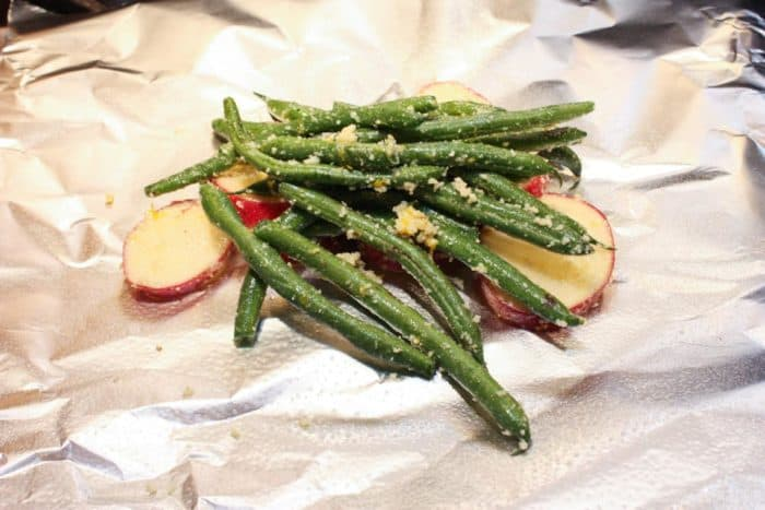 Green beans and potatoes on foil for preparing Lemon Chicken Foil Packets