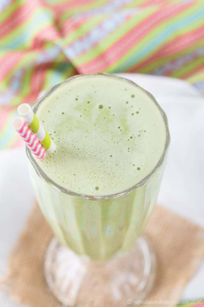 Healthy Shamrock Shake Mint Green Smoothie in a glass with striped straws