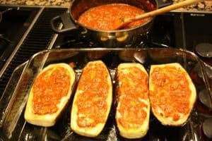 Stuffing the eggplants with cheese and sauce