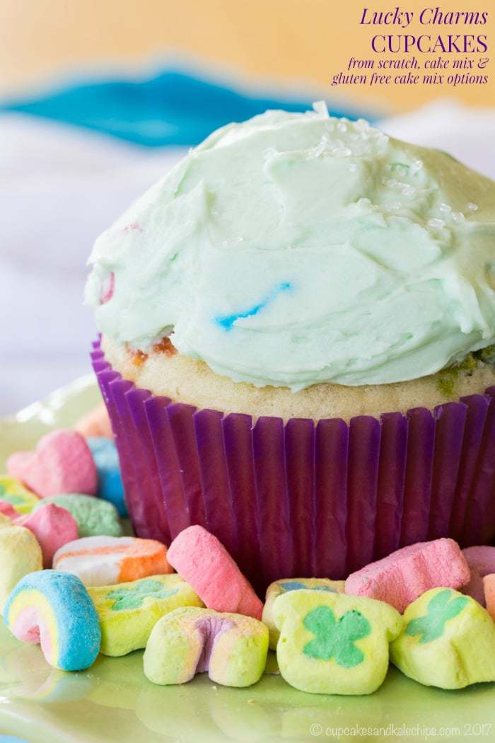 Lucky Charms Cupcakes - flavored with cereal milk, marshmallows in the frosting, and scratch, box mix, or gluten free cake mix options.