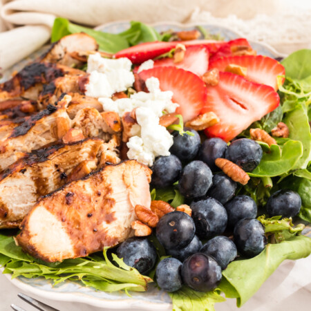 Mixed greens topped with grilled chicken, blueberries, strawberries, goat cheese, pecans, and blueberry balsamic vinaigrette