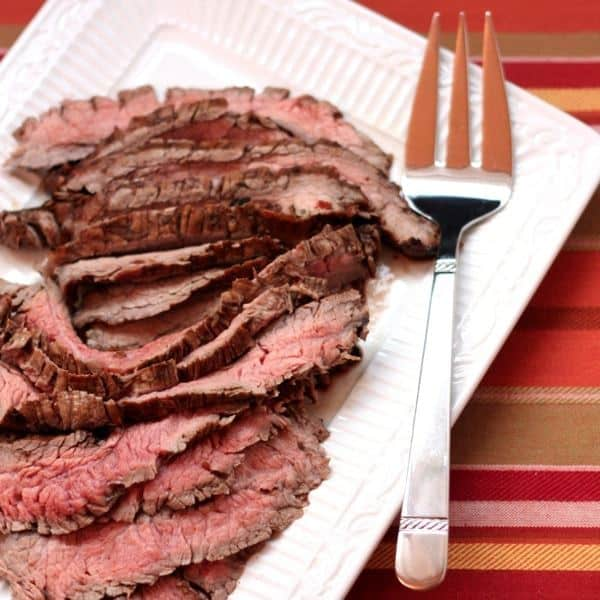 Sundried Tomato, Rosemary, and Balsamic Marinated Flank Steak | cupcakesandkalechips.com #steak #grilling #beef