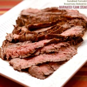 strips of marinated grilled flank steak on white platter