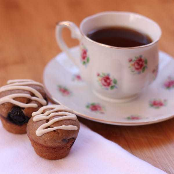 Two Gluten Free Almond Blueberry Mini Muffins with Tea cup