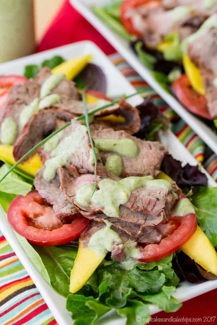 Mixed Greens topped with leftover steak, mango and tomato slices, and avocado ranch dressing