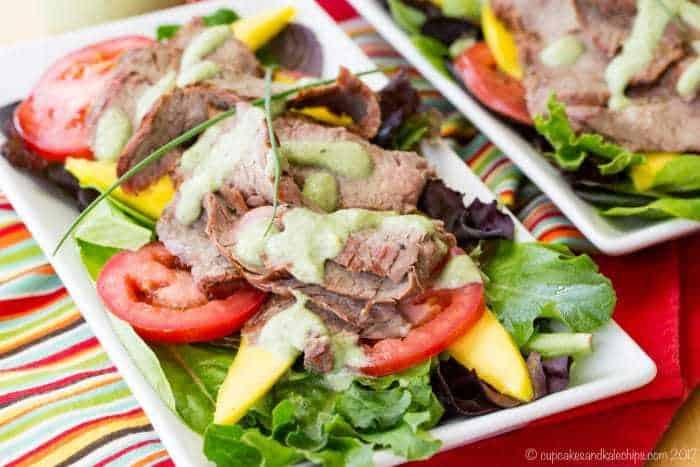 Avocado Ranch Steak Salad with Mango on white rectangular plates
