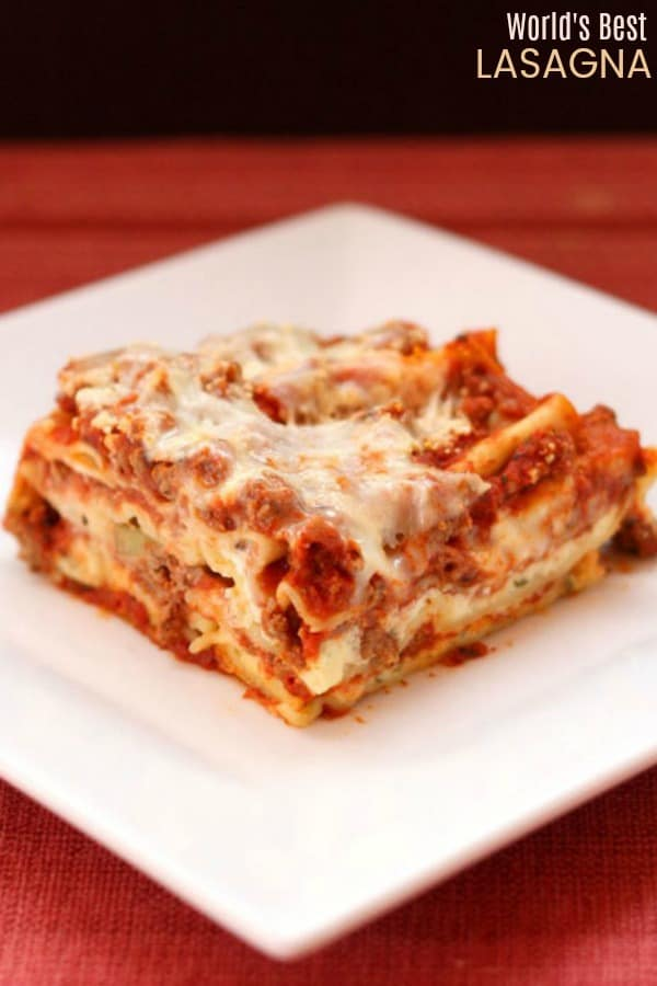 World's Best Lasagna - the ultimate recipe for classic Italian comfort food with layers of pasta, meat sauce, and cheese. #cupcakesandkalechips #lasagna #worldsbestlasagna #pasta #bestrecipe #italianfood #noodles #comfortfood
