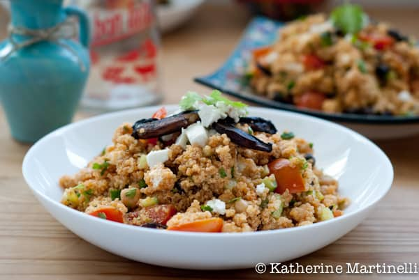 Quinoa Salad with tomatoes and feta in a serving bowl from Katherine Martinelli
