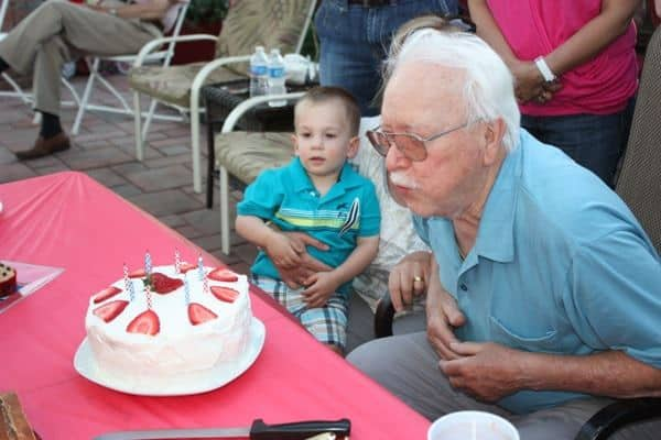 Grandpa blowing out candles