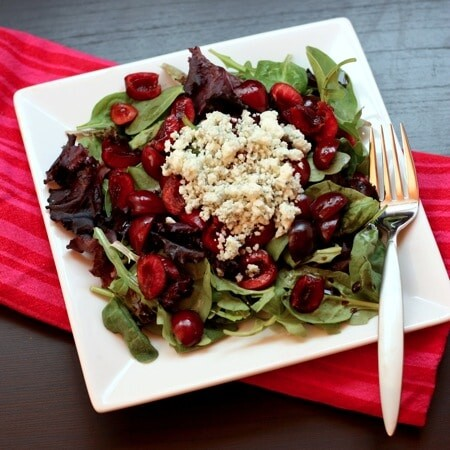 This fresh summer salad is made with cherries and blue cheese.