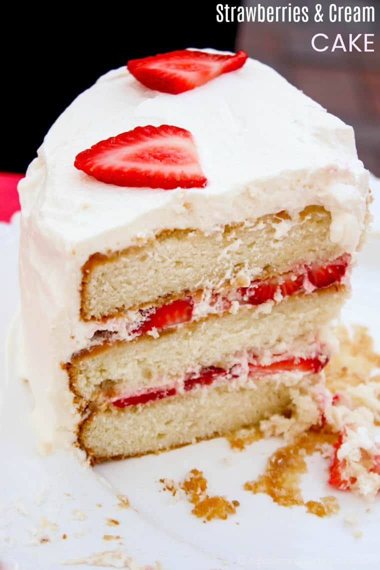 Strawberries and Cream Cake - the classic combination of white layer cake, fresh strawberry filling, and homemade whipped cream is a timeless dessert recipe for spring and summer. Bake it from scratch or start with a cake mix. #cupcakesandkalechips #cake #cakerecipe #layercake #strawberries #whippedcream #dessert #fourthofjuly #memorialday