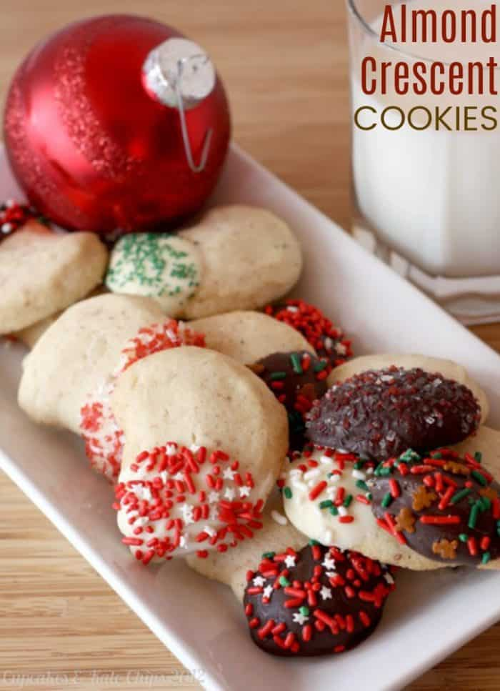 Almond Crescents Cookies Recipe on a white plate with an ornament