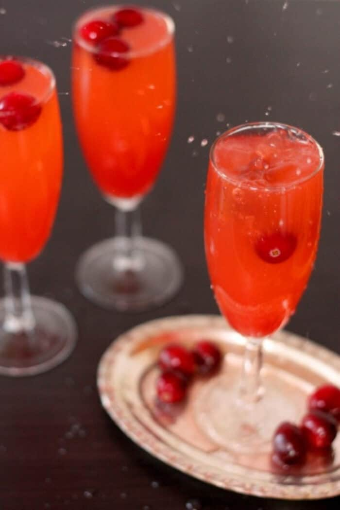 Fresh cranberry splashing into a Fizzy mocktail