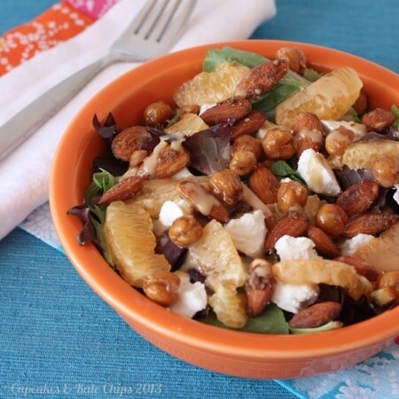 Orange roasted chickpeas, creamy goat cheese, and spiced almonds are a delicious combination in this quick and easy-to-make dinner salad. | Cupcakesandkalechips.com
