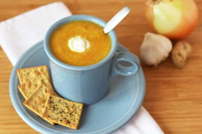Healthy Vegetable Soup in a mug with crackers