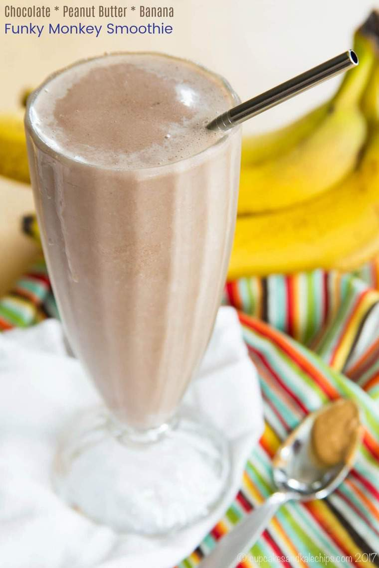 Chocolate Peanut Butter Banana Smoothie in a tall glass with ingredients in the background