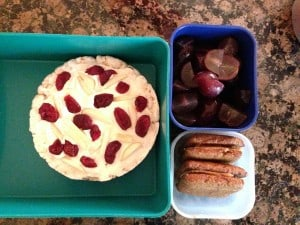 Rice cake with Laughing Cow cheese and dried cranberries, grapes, graham cracker and peanut butter sandwiches