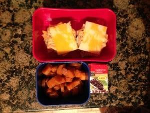 Cheese & gluten free crackers, carrots, and raisins