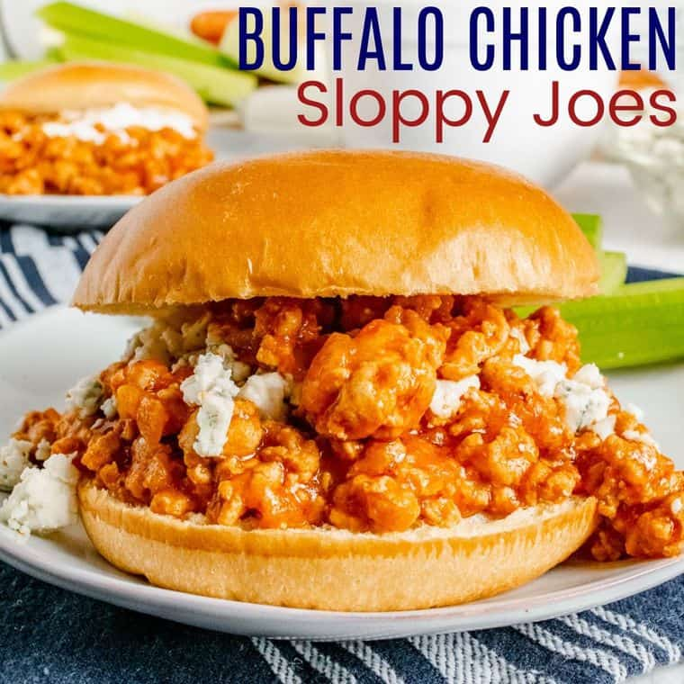 Ground chicken mixture spilling off the sides of a buffalo chicken sloppy joe on a roll