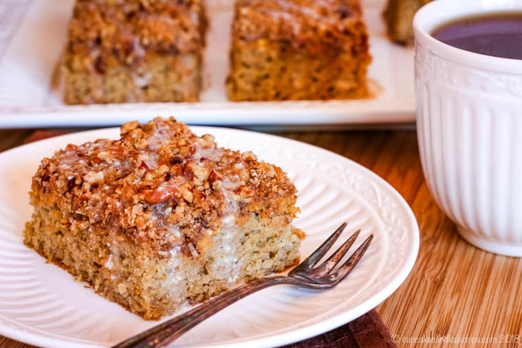 Gluten Free Pumpkin Swirl Pecan Crumb Cake with a cup of coffee