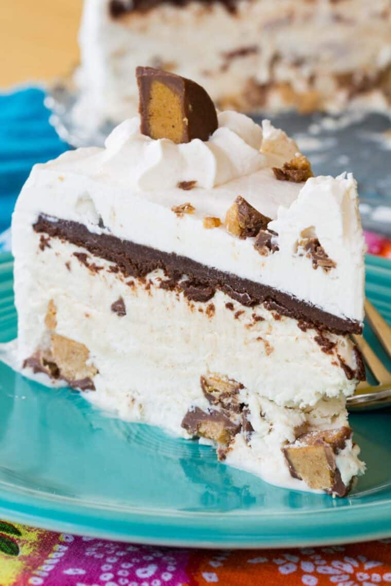 a piece of Peanut Butter Cup Ice Cream Cake on a turquoise plate