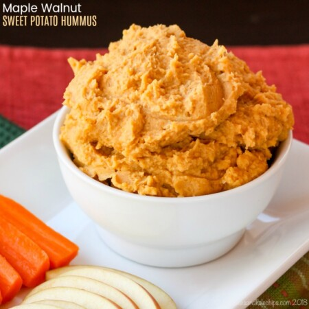 A bowl of Maple Walnut Sweet Potato Hummus