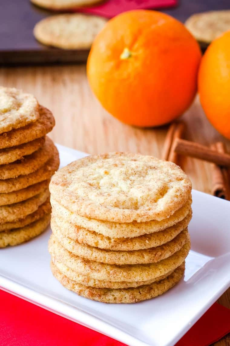 Stack of Cardamom Orange Cookies on a white rectangular plate