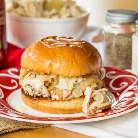 crockpot pulled chicken with apples on a roll with cheddar cheese