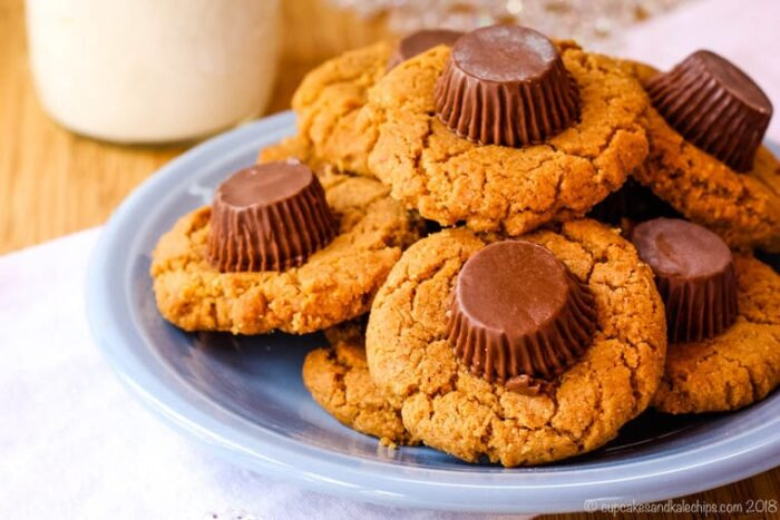 A blue plate of Flourless Peanut Butter Blossom Cookies with Reese's Peanut Butter Cups