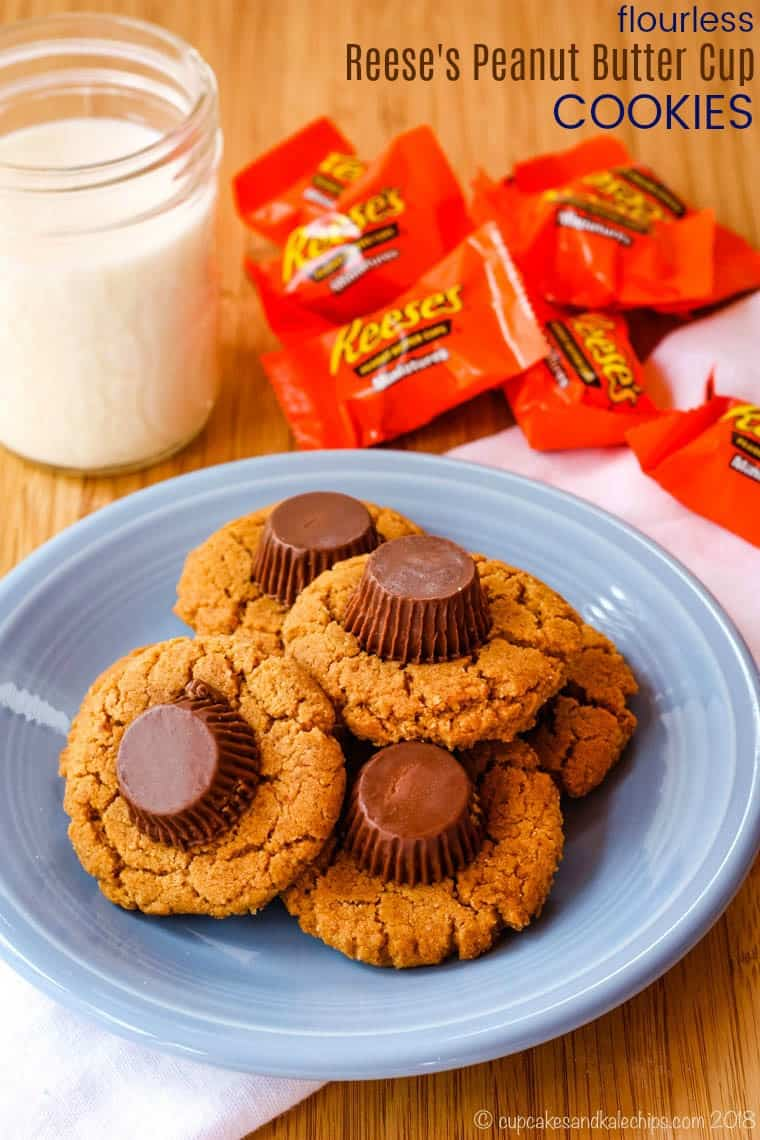 Flourless Reese's Peanut Butter Cup Cookies - this easy cookie recipe has double the peanut butter plus chocolate, and no flour making them naturally gluten free. These are always a favorite for Christmas or as a treat for the kids any day of the year. #cookies #peanutbuttercups #glutenfree
