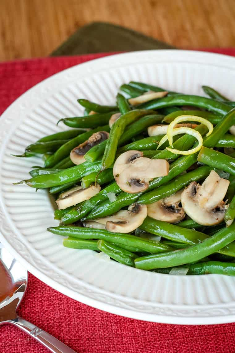 Finished green beans and mushrooms recipe in a serving bowl