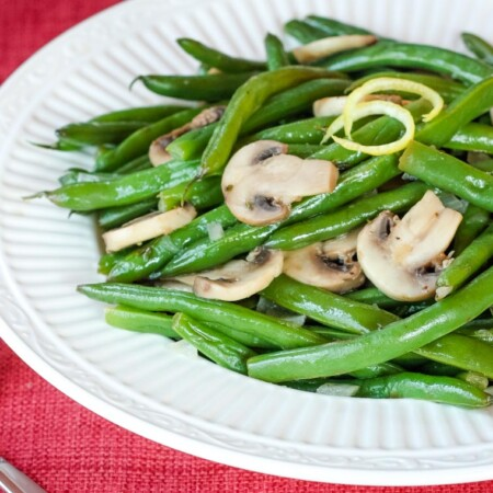 Lemon Green Beans and Mushrooms in a white serving bowl