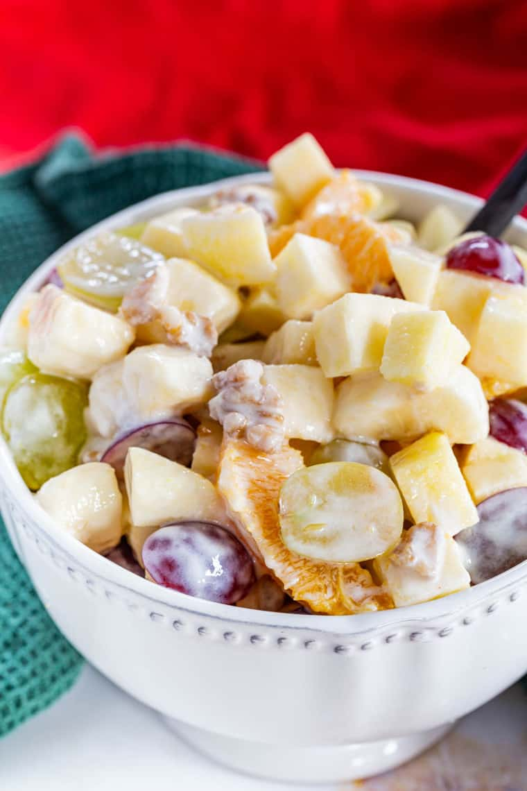 "Waldorf Fruit Salad is a sweet and juicy mixture of seasonal fruits lightly coated with a honey Greek yogurt ""dressing"" and some toasted walnuts for crunch."