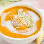Thai Butternut Squash Soup served in a bowl with soup spoon