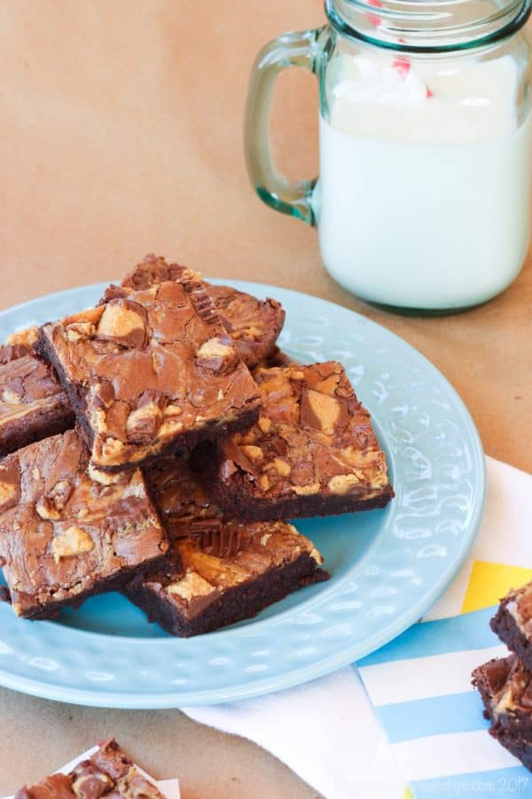 Flourless Peanut Butter Cup Swirl Brownies - for all the chocolate and peanut butter lovers, this rich, fudgy brownie recipe is swirled with peanut butter and loaded with Reese's Peanut Butter Cups. An easy gluten free dessert!