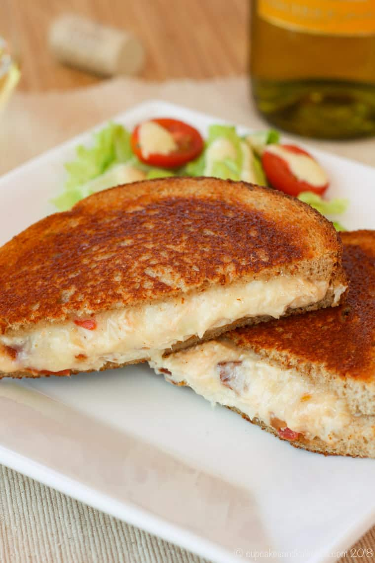 Grilled cheese served on a plate with a salad