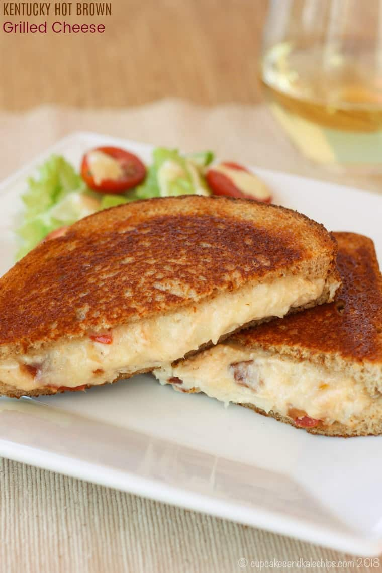 Kentucky Hot Brown Grilled Cheese cut diagonally and stacked on a plate