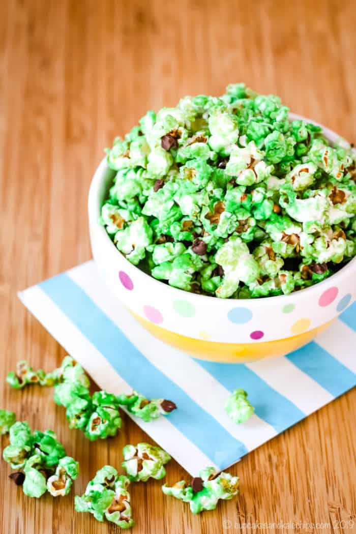 Mint Chocolate Chip Popcorn spilling out of a bowl