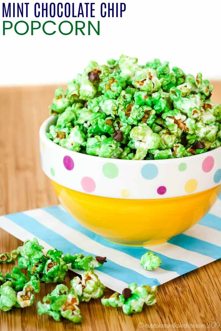 Green Popcorn with Chocolate Chips  overflowing from a yellow bowl