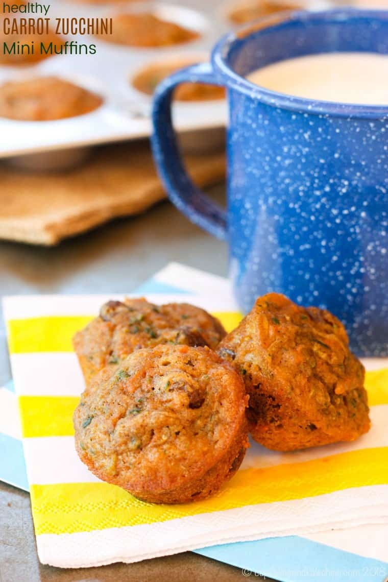 Healthy Carrot Zucchini Mini Muffins - a kid-favorite muffin recipe that is moist and sweet, but packed with whole wheat and vegetables, and sweetened with just a touch of maple syrup. Perfect for breakfast or a healthy snack. One of the most popular recipes on the blog! #cupcakesandkalechips #wholegrain #healthysnack #minimuffins #zucchinimuffins #zucchini #breakfast