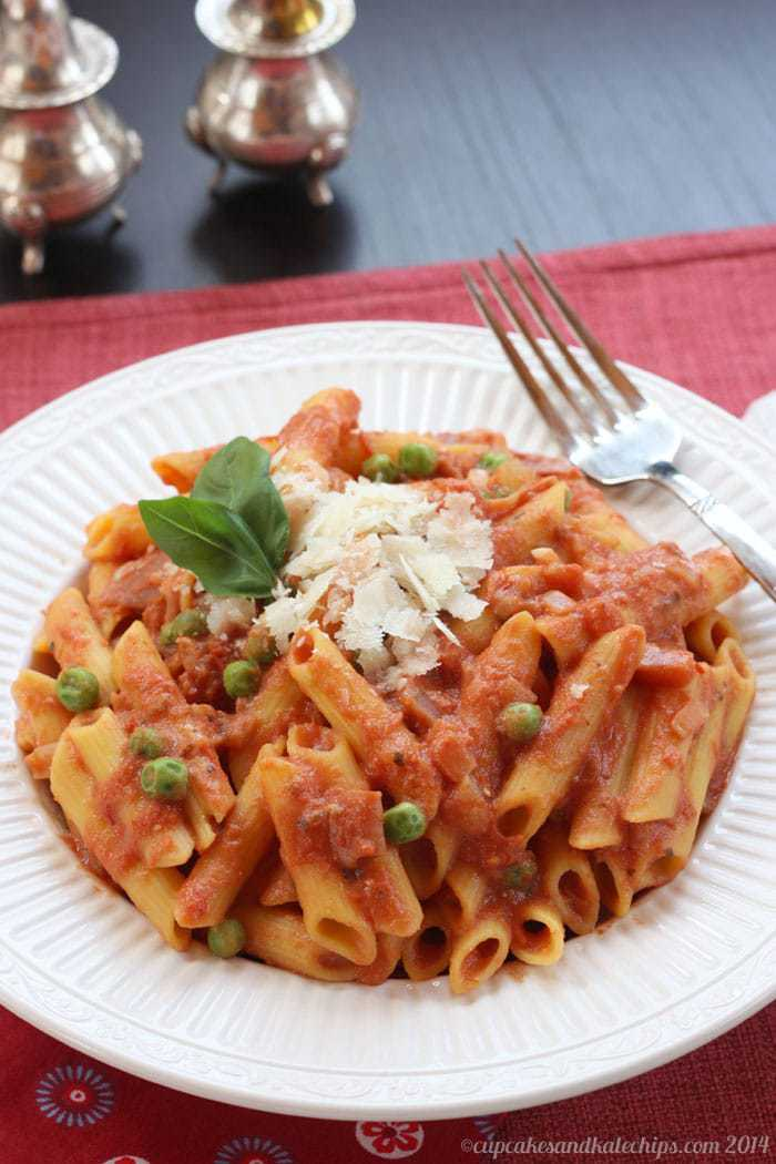bowl of penne with tomato cream sauce and parmesan on top
