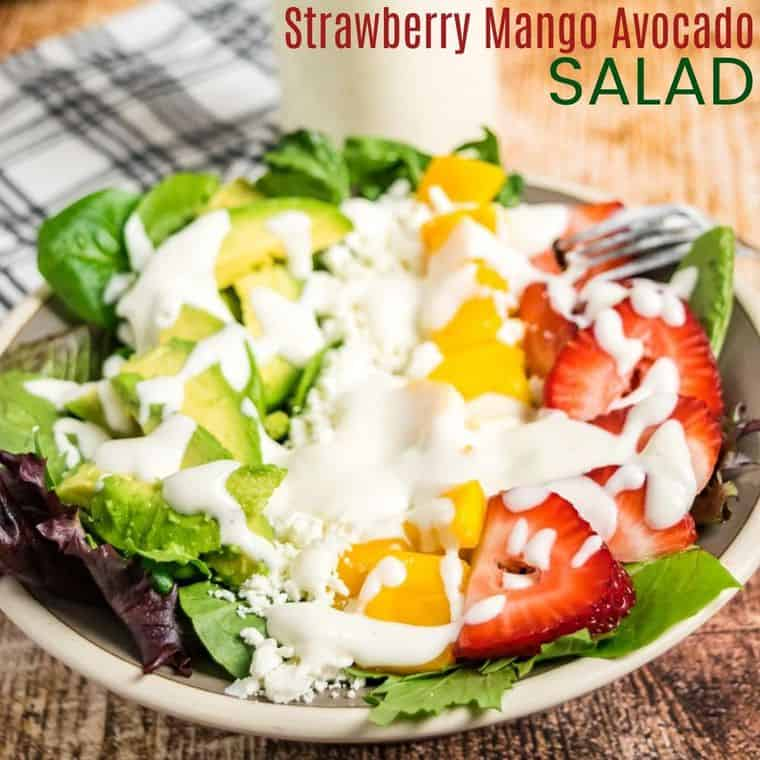 Strawberry Mango Avocado Salad with Goat Cheese and Pine Nuts with the best light Honey Lemon Lime Dressing | cupcakesandkalechips.com | #glutenfree #vegetarian