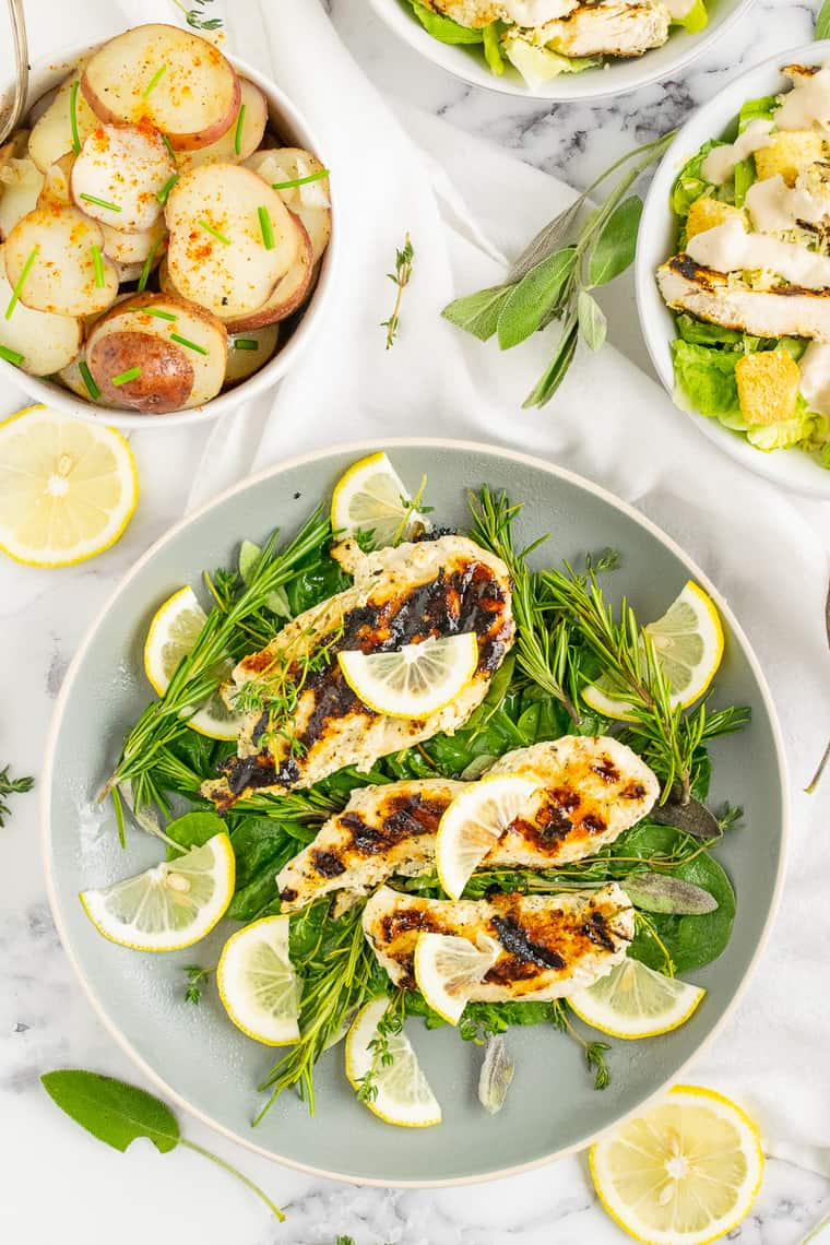 Overhead of Lemon Herb chicken on a pile of greens on a plate