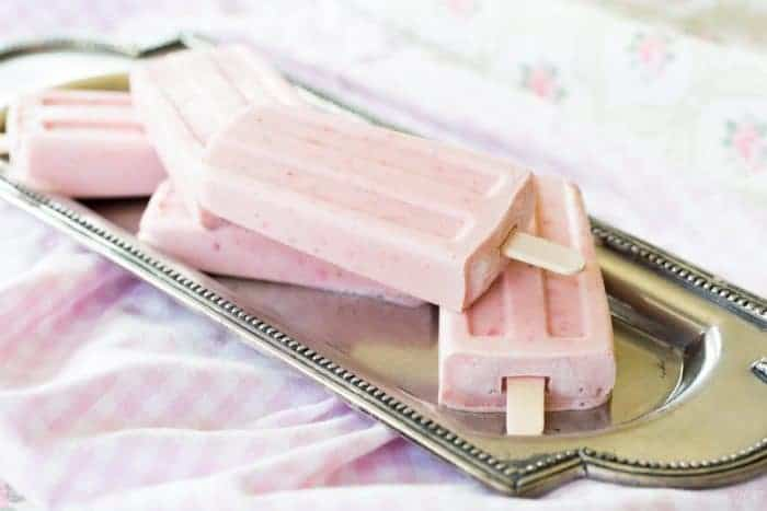 Strawberry Cheesecake Frozen Yogurt Popsicles on a silver platter