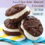 These homemade ice cream sandwich cookies are made with coconut gelato and sandwiched between two chocolate almond cookies.