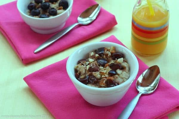 Reheated Meal Prep Breakfast Frozen Oatmeal Cups with nuts and cherries