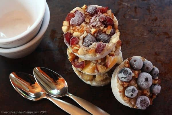 Freezer oatmeal cups make ahead breakfast stacked on a sheet pan ready to reheat