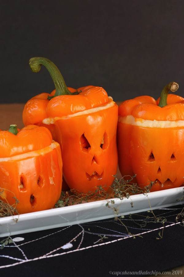 Halloween Stuffed Peppers with Ground Beef carved like jack o' lanterns