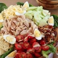 big serving bowl of turkey cobb salad